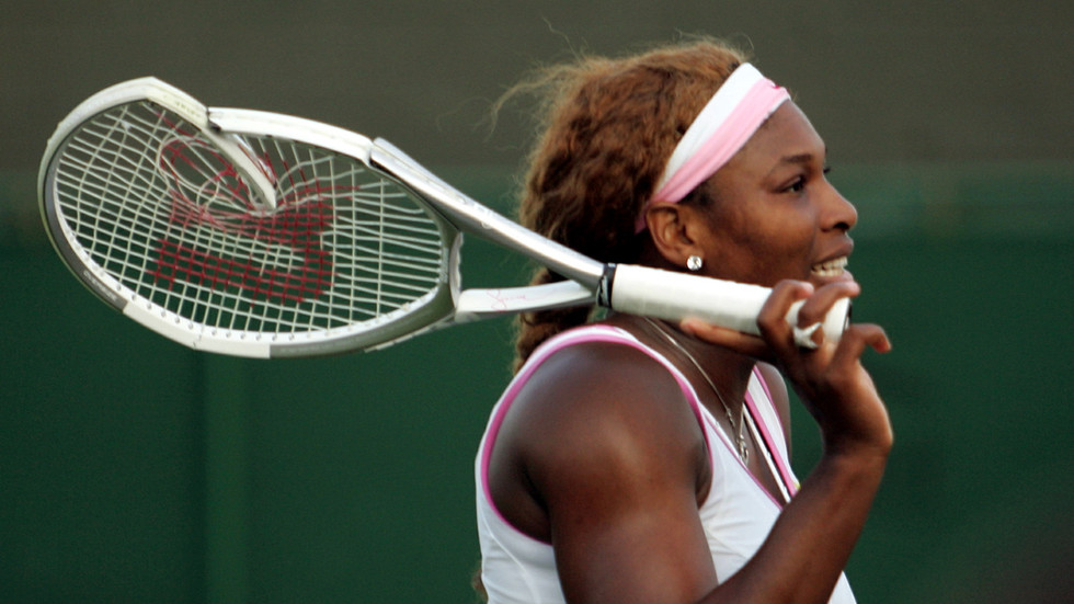 Serena Williams reacts after smashing her racquet