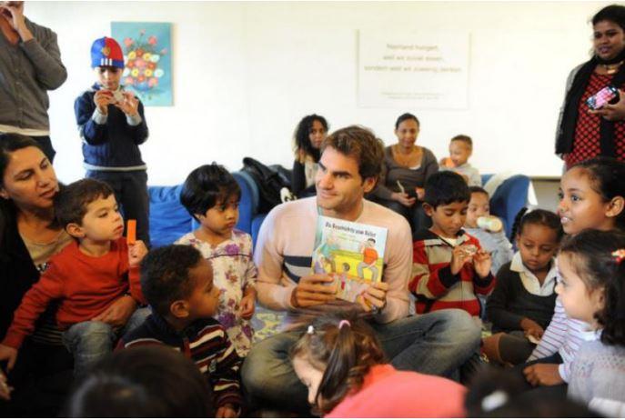 Roger Federer with todlers