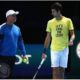 Novak Djokovic and coach walk