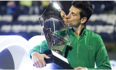Novak Djokovic kiss trophy