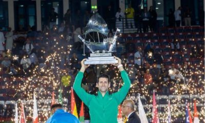 Novak Djokovic raise trophy
