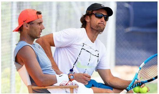Rafael Nadal sit with coach