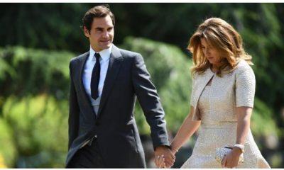 Roger Federer and wife walk