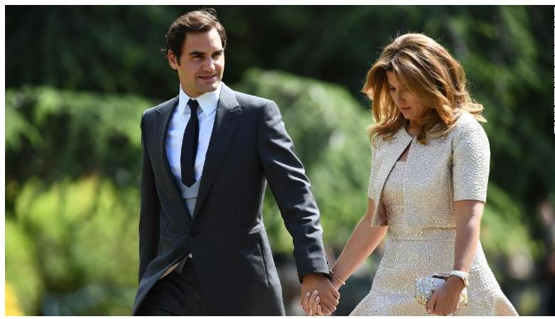 Roger Federer and wife walk