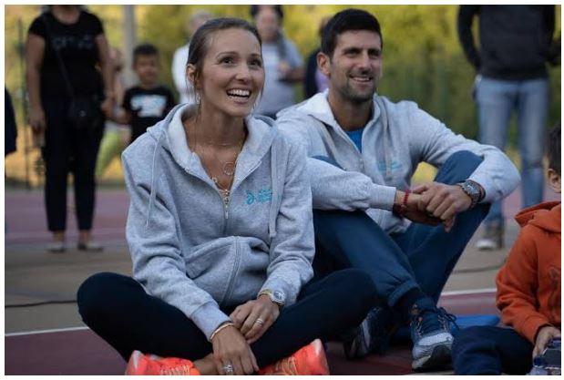 Novak Djokovic and wife sit