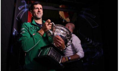 Novak Djokovic holding trophy