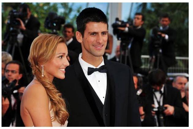 Novak Djokovic smiling with wife
