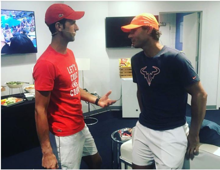 Rafael Nadal and Novak Djokovic stand