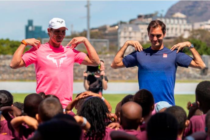 Rafael Nadal and Roger Federer exercise