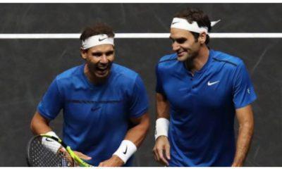 Rafael Nadal and Roger Federer smile