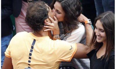 Rafael Nadal kisses wife