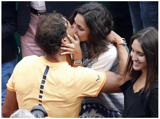 Rafael Nadal kisses wife