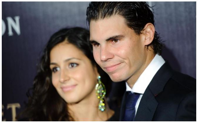 Rafael Nadal smiling with wife