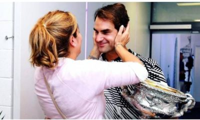 Roger Federer holds wife
