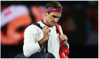 Roger Federer with bag