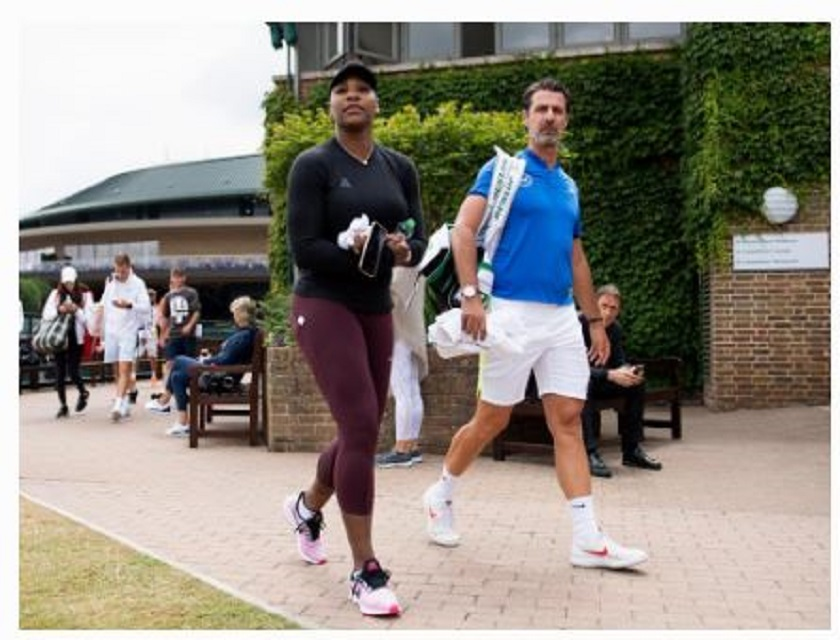 Serena Williams walking with coach