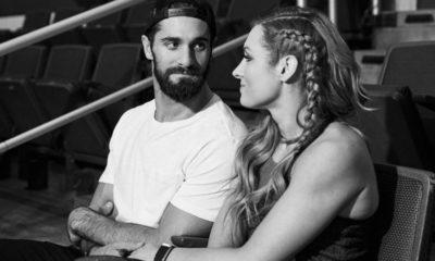 Seth Rollins and Becky Lynch sit