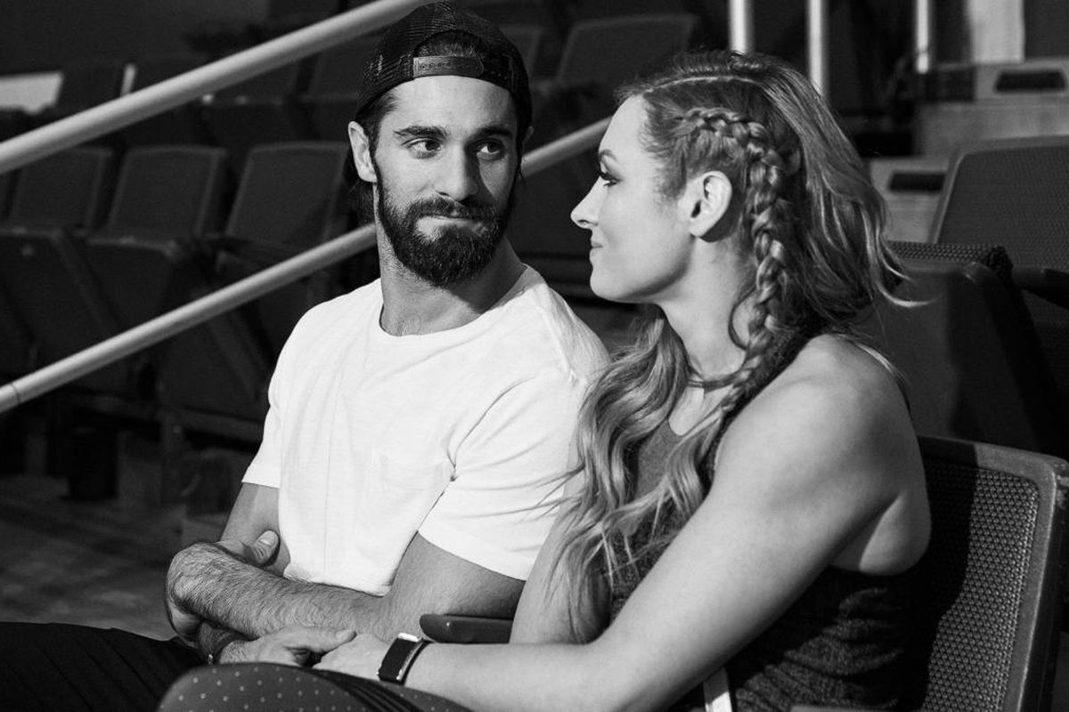 Seth Rollins and Becky Lynch sit