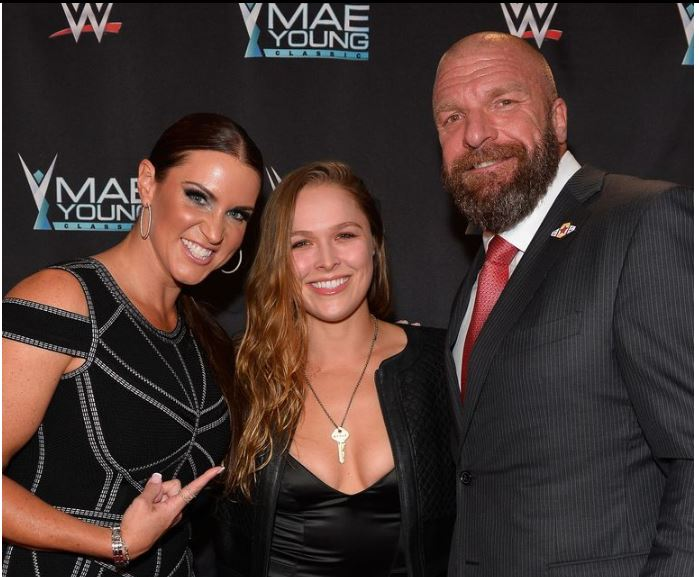 Triple H , Stephanie and Ronda Rousey