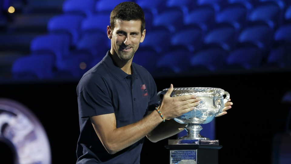 Novak Djokovic holds trophy
