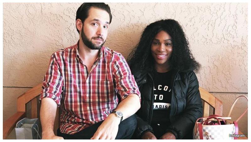 Serena Williams and husband sit