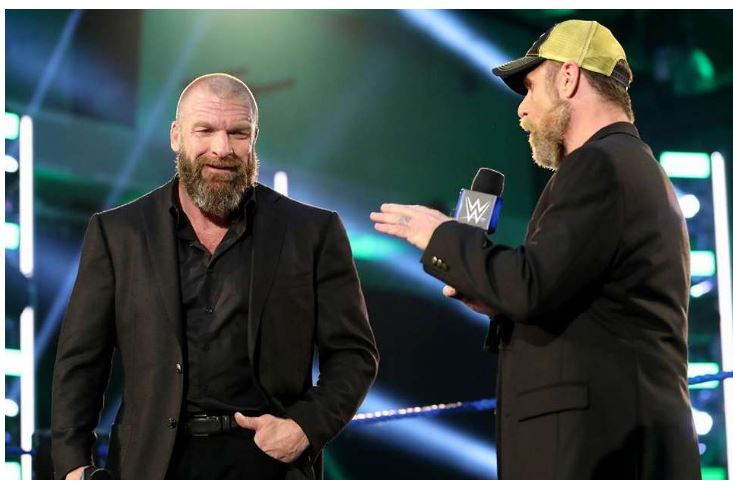 Triple H and Mick Foley