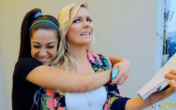 Bayley and Renee Young