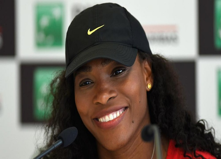 Serena Williams smiles, happy